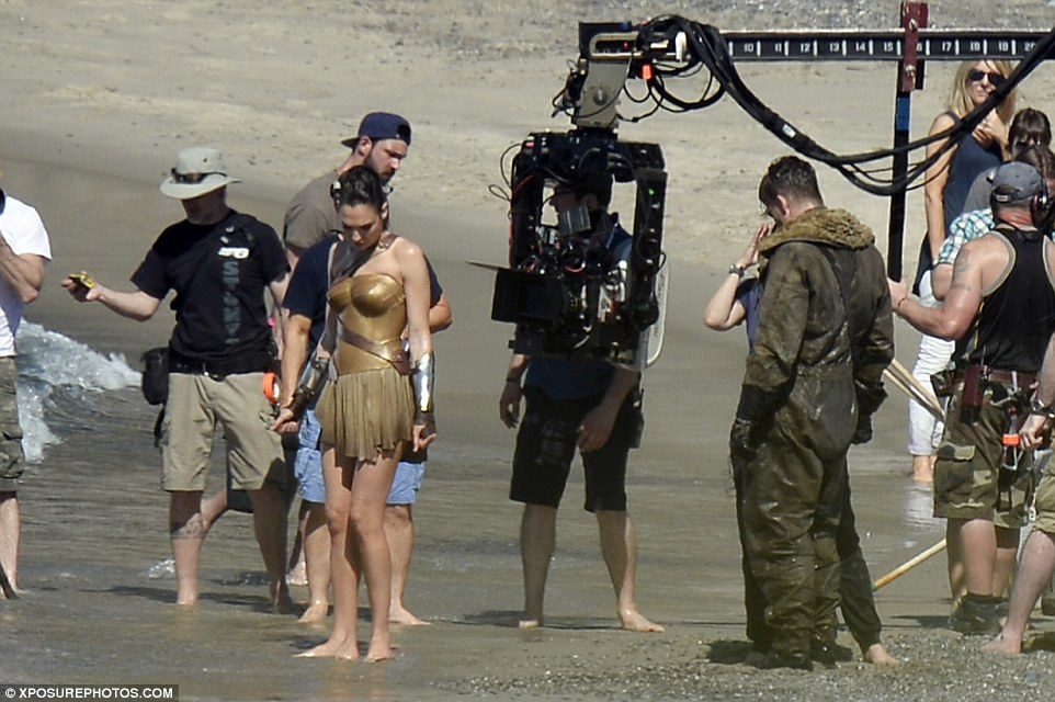 New Pics See Wonder Woman Saving Steve Trevor on the Shores of Themyscira!