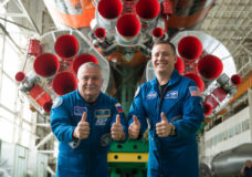 "jsc2017e043850 (April 14, 2017) --- In the Integration Facility at the Baikonur Cosmodrome in Kazakhstan, Expedition 51 crewmembers Fyodor Yurchikhin of the Russian Federal Space Agency (Roscosmos, left) and Jack Fischer of NASA (right) provide a ""thumbs up"" as they pose for pictures April 14 in front of their Soyuz booster rocket. Fischer and Yurchikhin will launch April 20 on the Soyuz MS-04 spacecraft for a four and a half month mission on the International Space Station. Credit: NASA/Gagarin Cosmonaut Training Center/Andrey Shelepin"