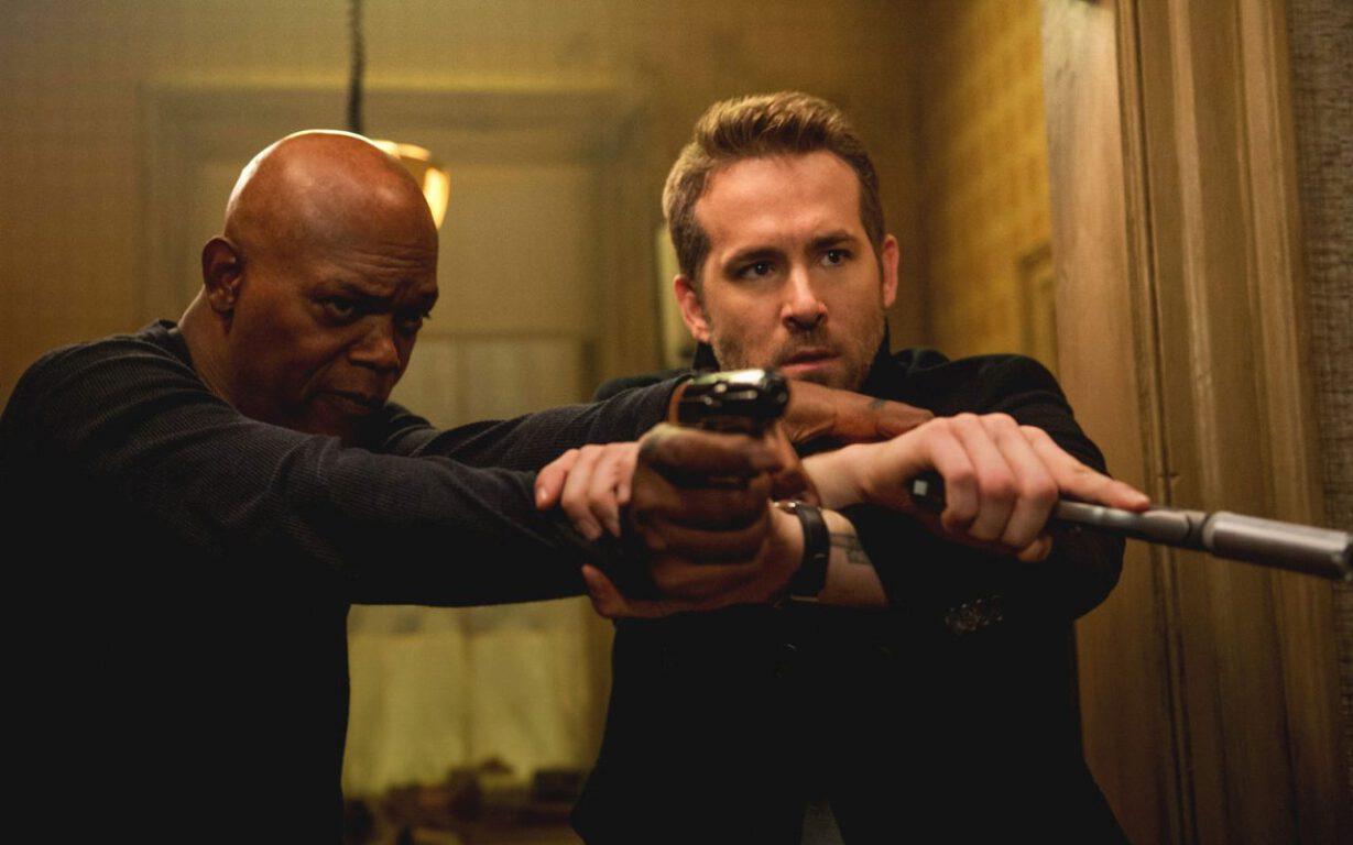 Geek Girl Authority Movie Review Hitman's Bodyguard Samuel L. Jackson as Darius Kinkaid and Ryan Reynolds as Michael Bryce