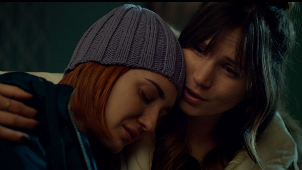 Katherine Barrell as Nicole Haught and Dominique Provost-Chalkley as Waverly Earp in Wynonna Earp.