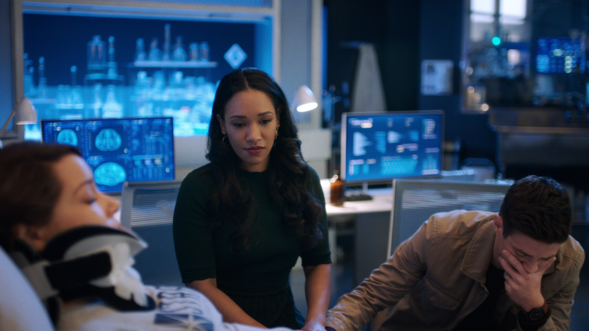 Barry and Iris sit with an injured Nora.
