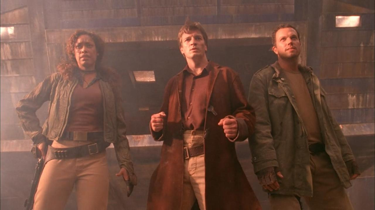 "Gina Torres as Zoe Washburne, Nathan Fillion as Captain Malcolm ""Mal"" Reynolds, and Alec Baldwin as Jayne Cobb in Firefly, imdb.com"