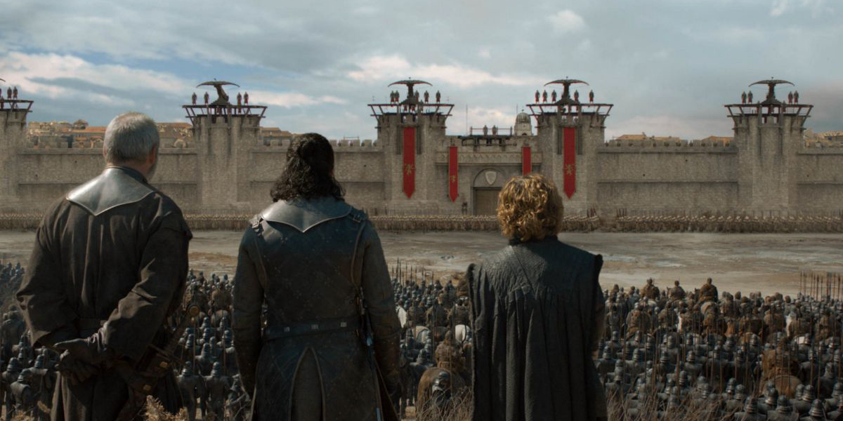 Davos, Jon Snow and Tyrion regard King's Landing on Game of Thrones