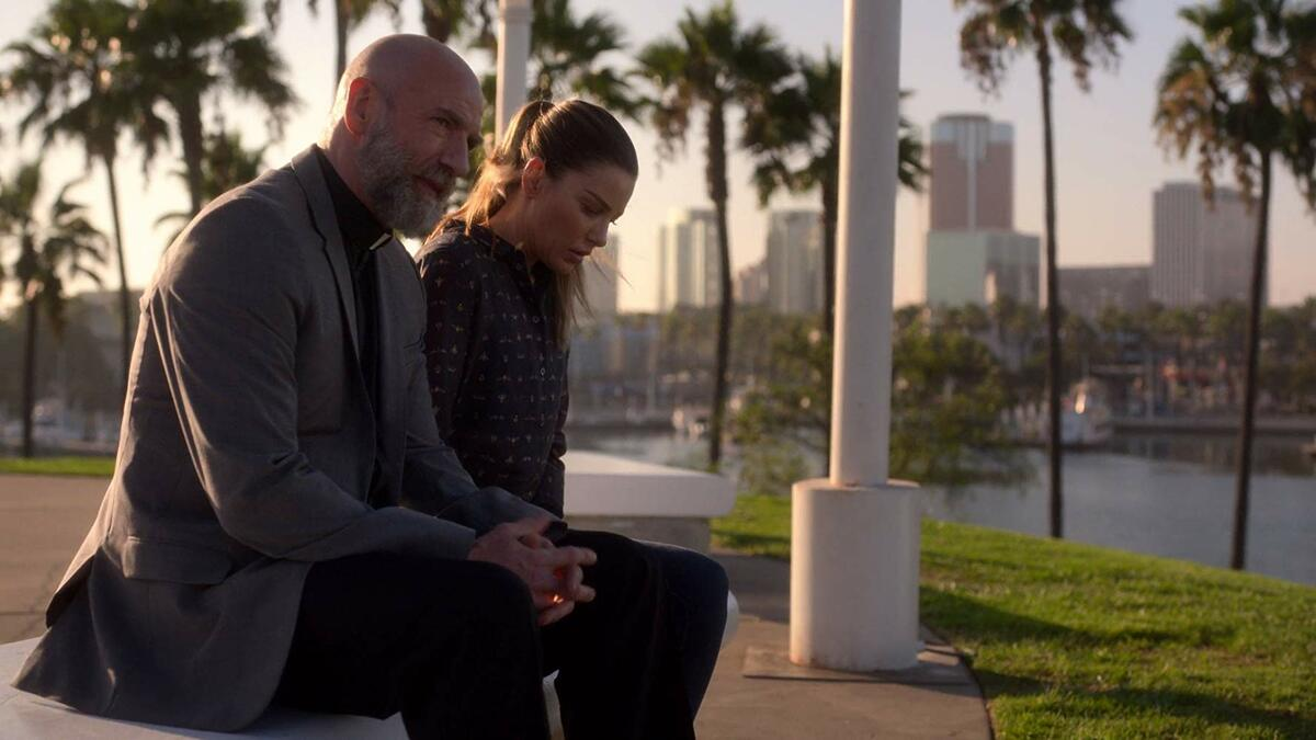 Chloe consults Father Kinley in Lucifer.