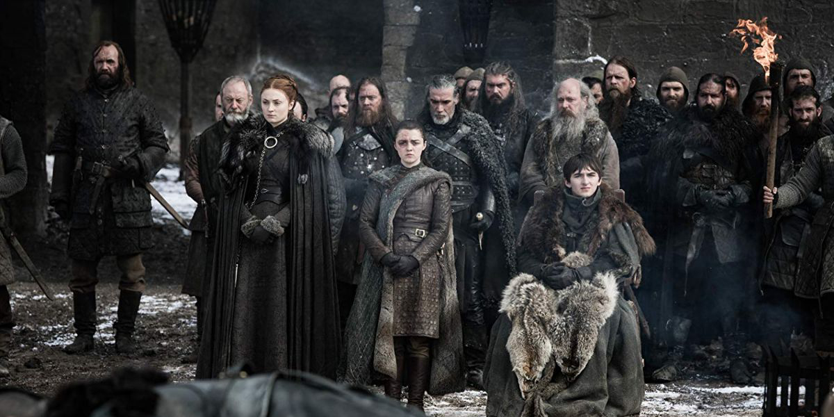 The Stark family and supporters look on during the funeral for those fallen in the Battle of Winterfell