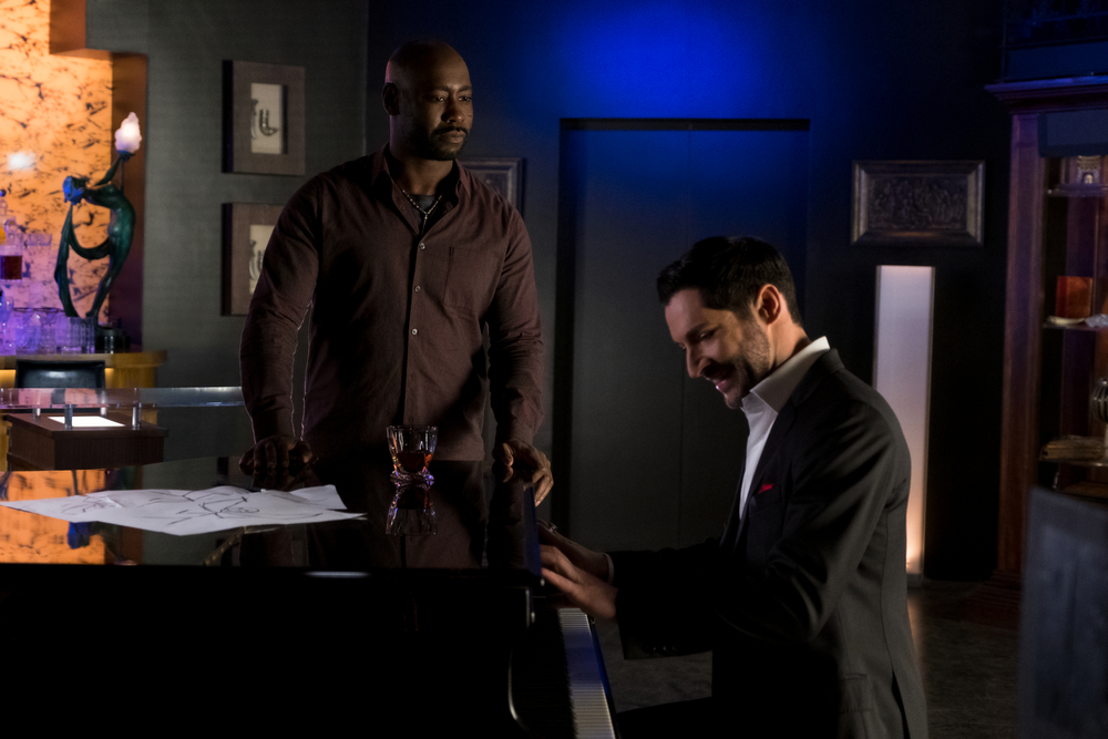 "D. B. Woodside as Amenadiel and Tom Ellis as Lucifer on Lucifer, ""Super Bad Boyfriend."" Courtesy of Netflix."
