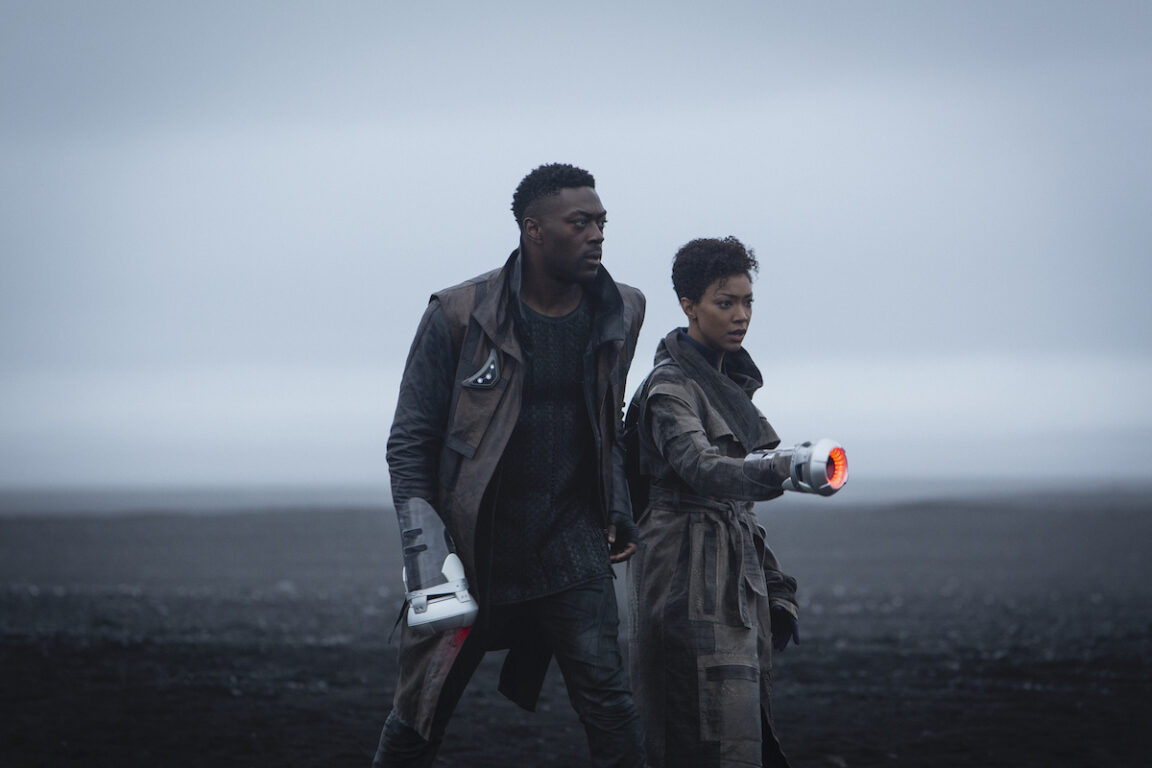Cleveland Booker and Michael Burnham holding new weapons on Star Trek: Discovery
