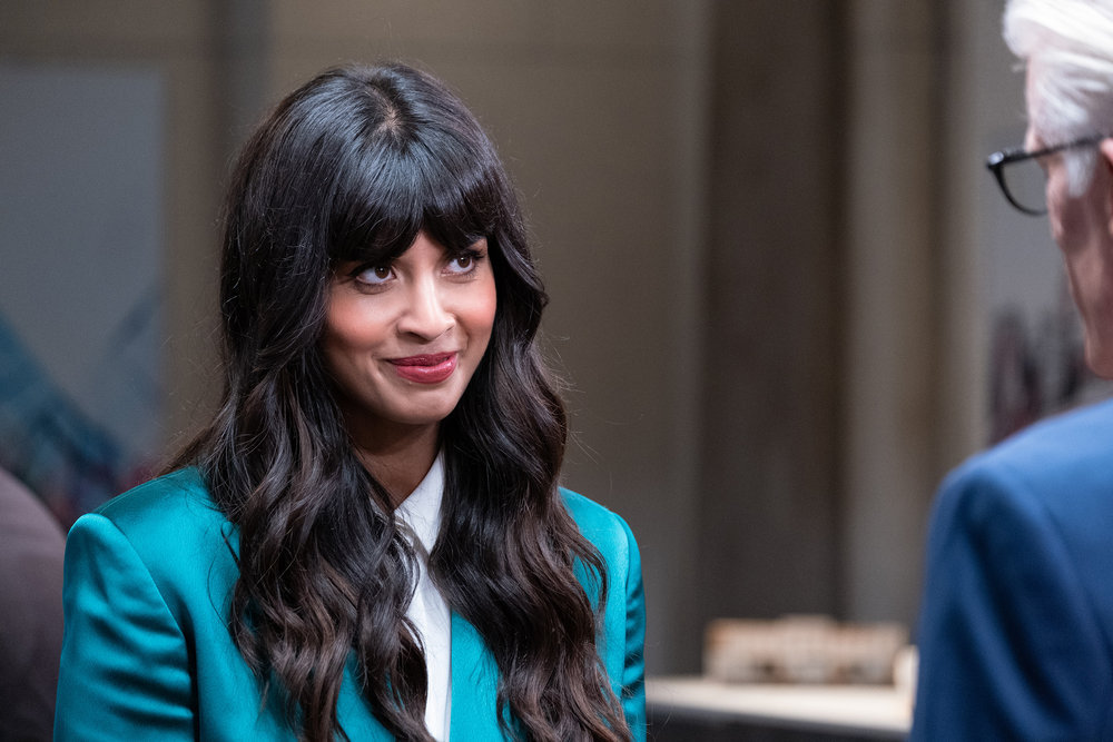 Tahani rocks a business suit and smiles