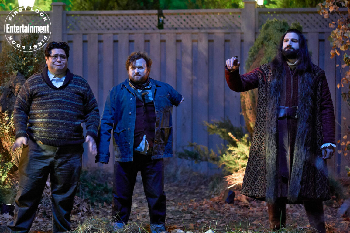 Still image of Harvey Guillén as Guillermo, Haley Joel Osment as Topher, Kayvan Novak as Nandor in What We Do in the Shadows