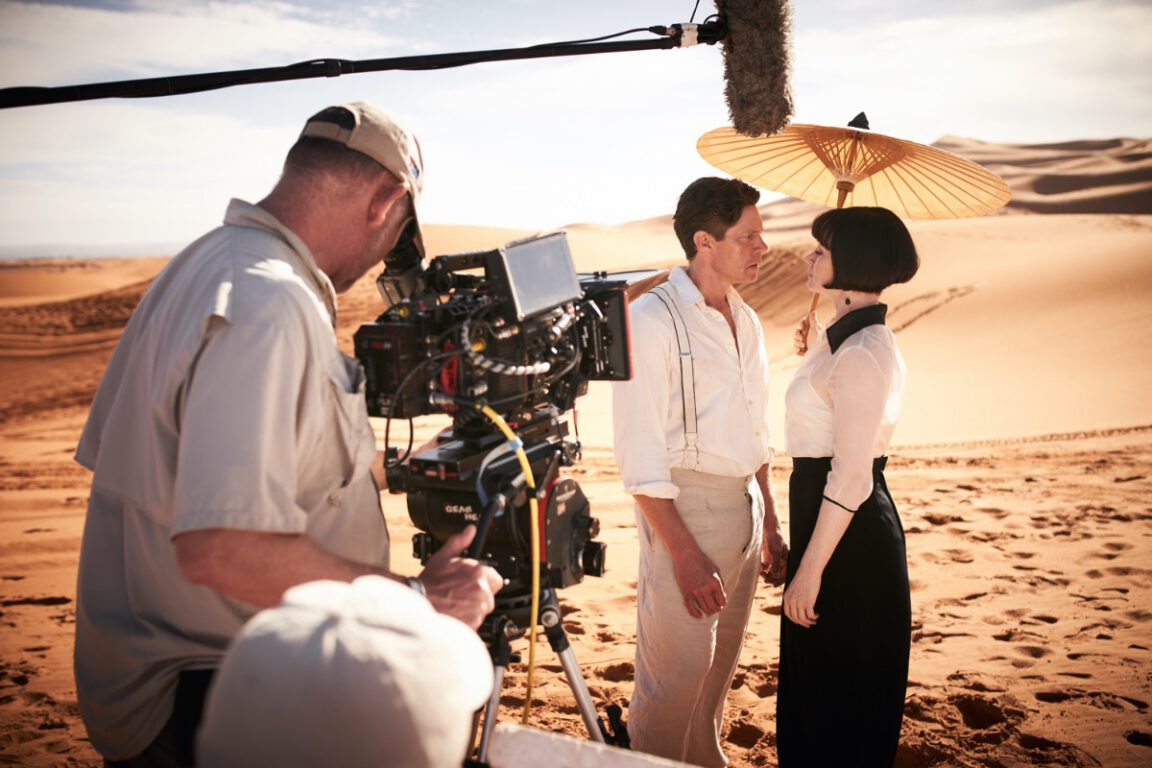 Miss Fisher and the Crypt of Tears Behind the Scenes: Brendan Shaw, Essie Davis and Nathan Page. Image Copyright Every Cloud Productions and all3media international