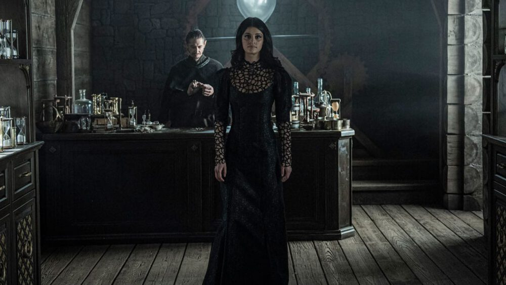 The Witcher's Yennefer visiting a shop in hopes of finding information on a cure for her infertiltiy.