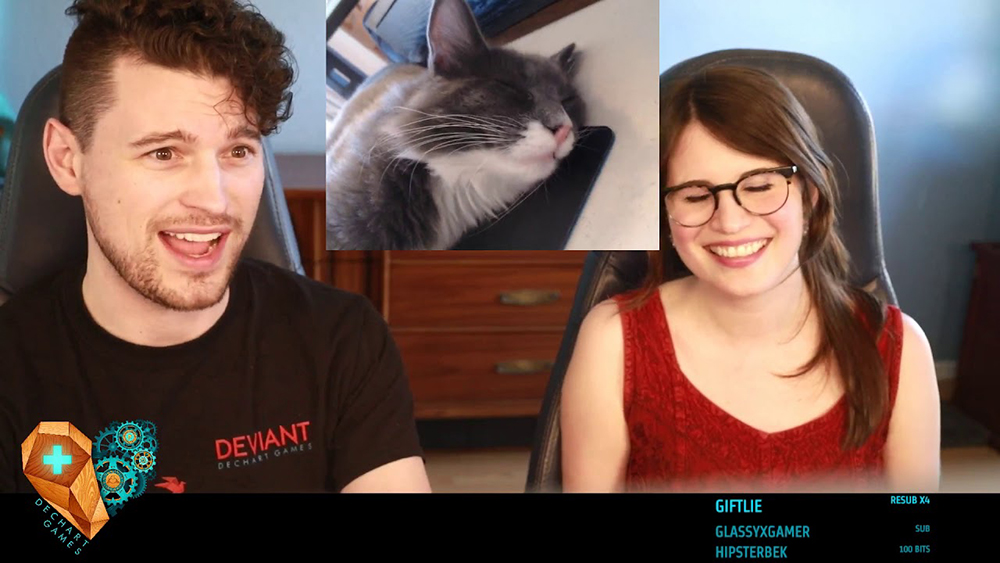 Bryan Dechart and Amelia Rose Blaire looking at a cat during DechartGames twitch stream.