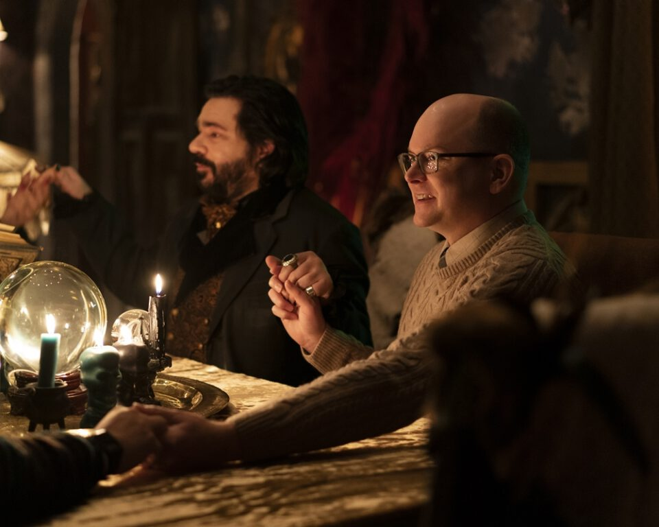 The group holds a seance in What We Do In The Shadows