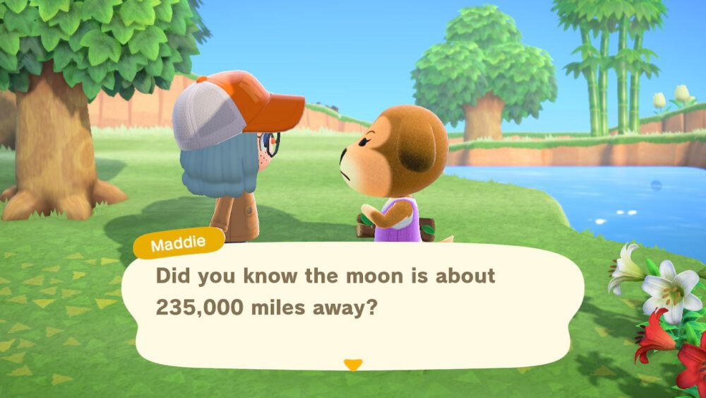 Me chatting with Maddie and learn how far the moon is from the Earth in Animal Crossing: New Horizons.