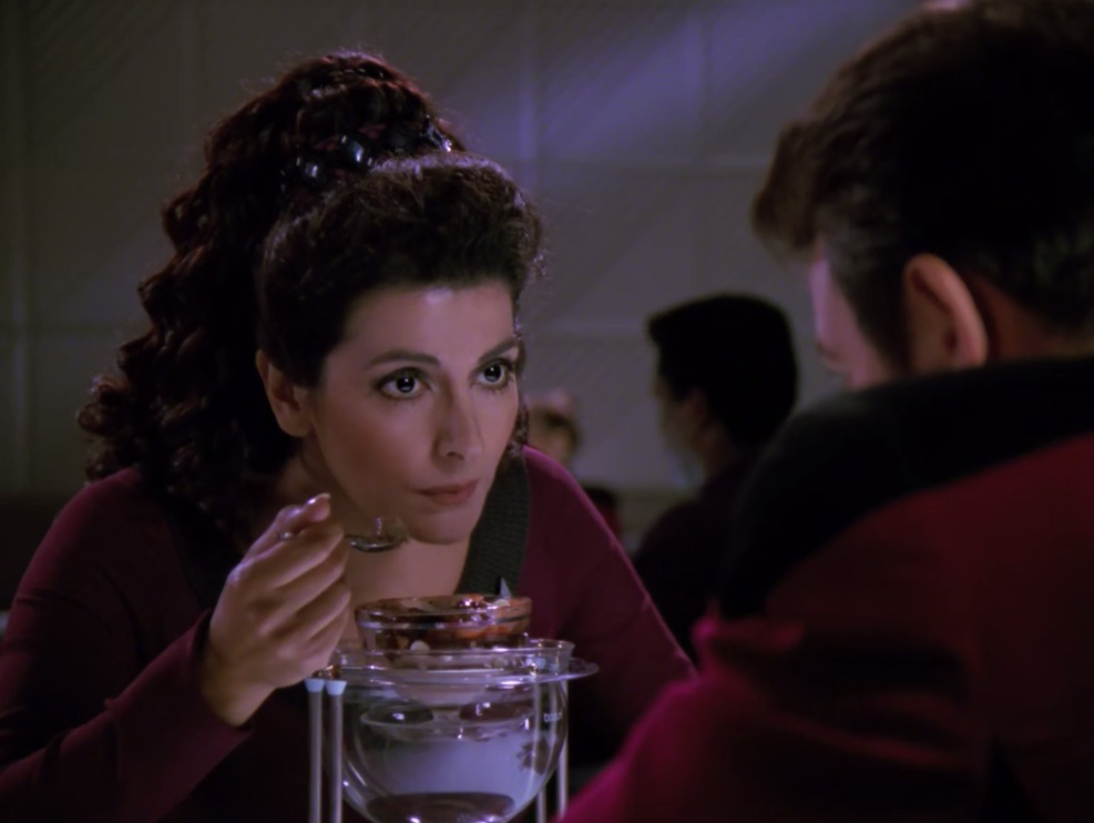 "Marina Sirtis as Counselor Deanna Troi eating a chocolate sundae in the episode ""The Game"" (s5e6) of Star Trek: The Next Generation"