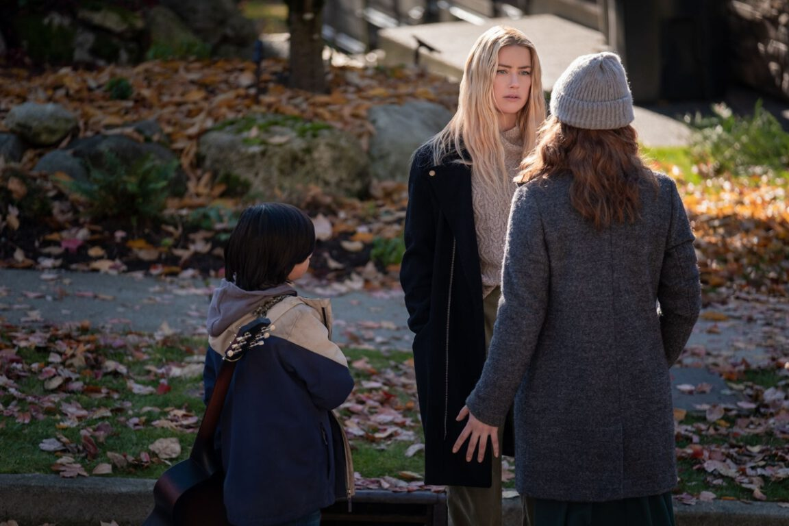 Amber Heard's Nadine Cross becomes a caregiver for a young boy named Joe (Gordon Kyle Diez Cormier) who has no one else in The Stand