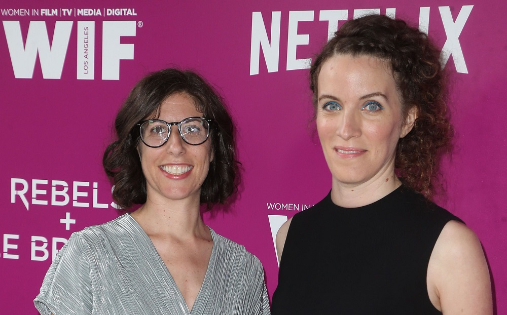 GLOW showrunners Carly Mensch and Liz Flahive