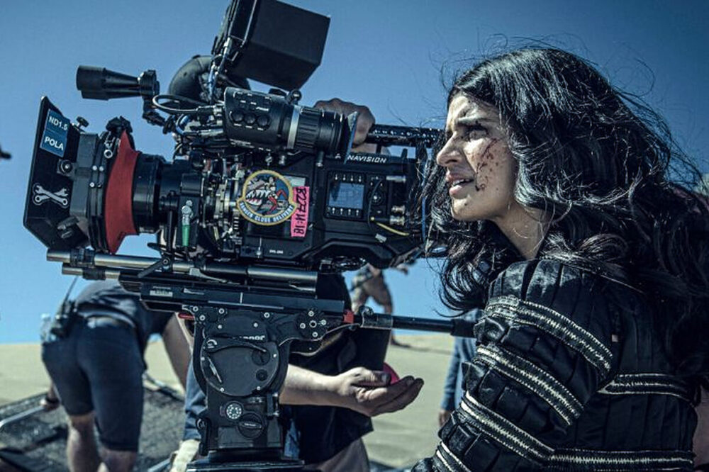 Anya Chalotra, who plays Yennefer of Vengerberg, behind the camera on the set of The Witcher Season 1