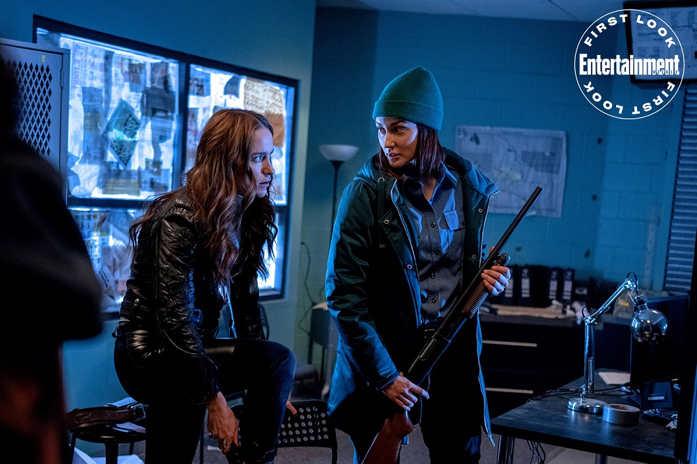 Still of Melanie Scrofano and Kat Barrell in Season 4 of Wynonna Earp, as used for SDCC 2020