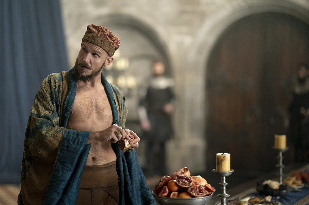 Still of Gustaf Skarsgard as Merlin in Cursed.