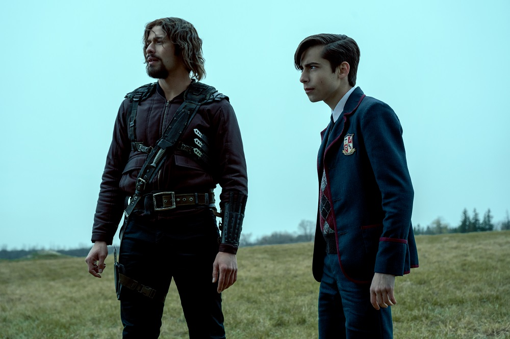 Still of David Castaneda and Aidan Gallagher in The Umbrella Academy.