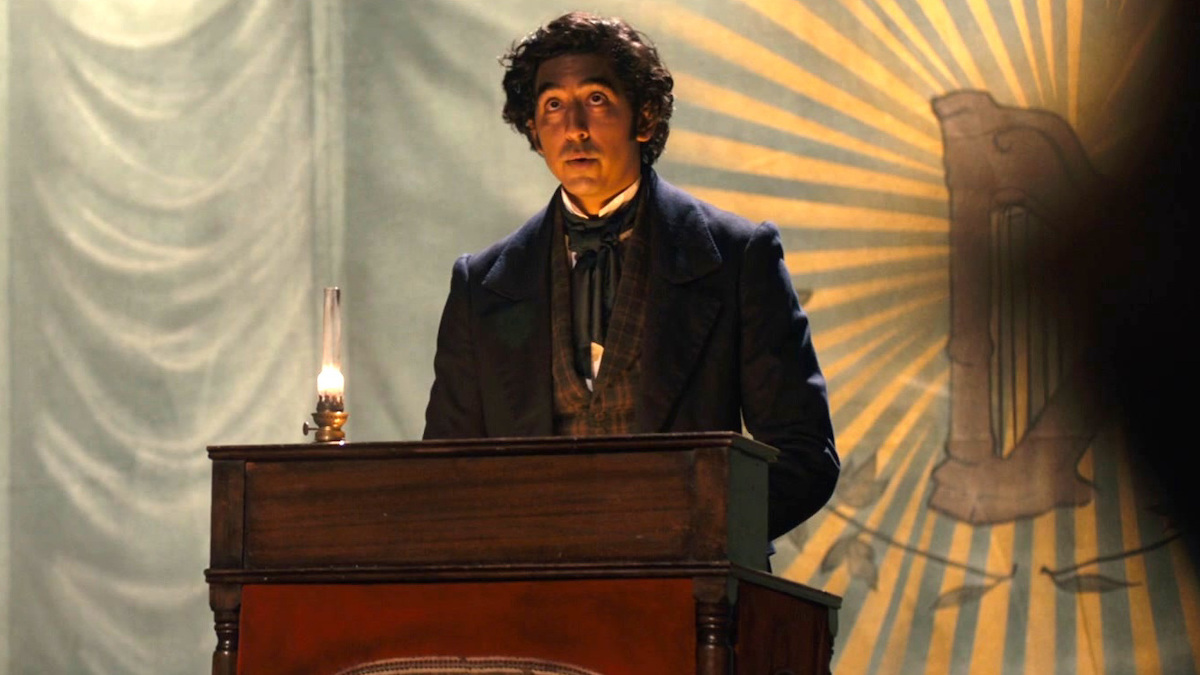 Dev Patel at a podium in The Personal History of David Copperfield
