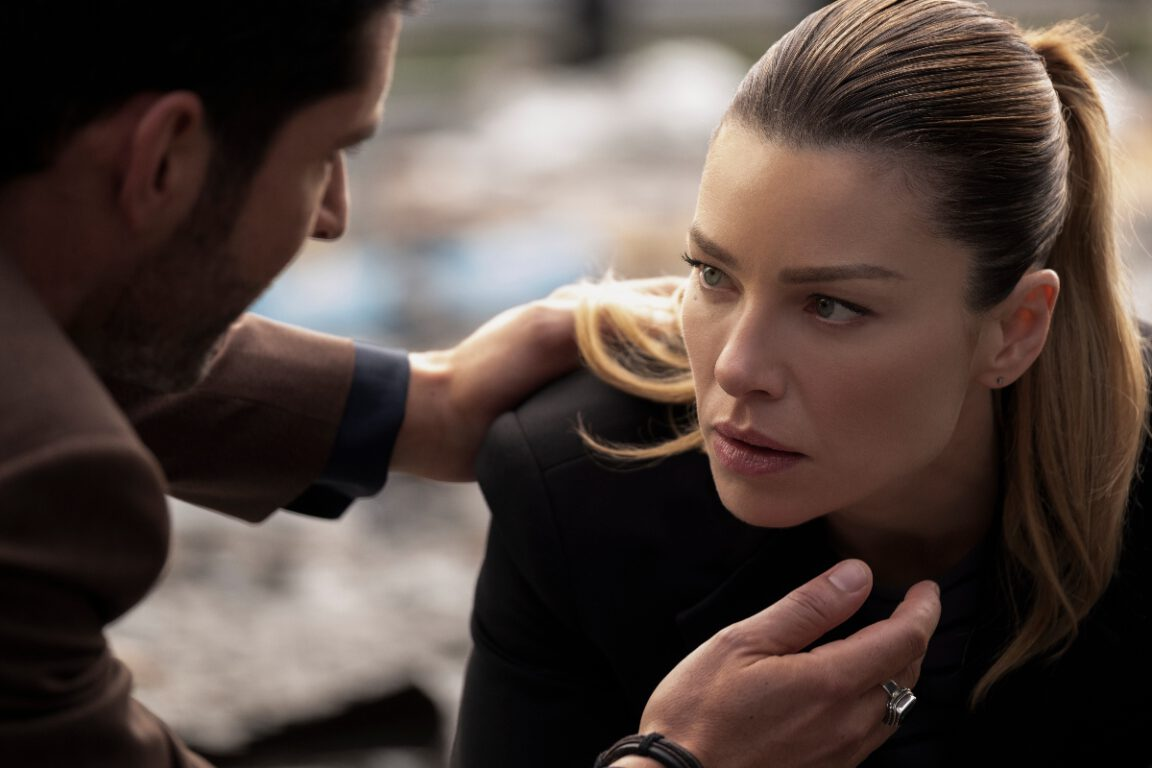 Lucifer checks on Chloe after an explosion on Lucifer