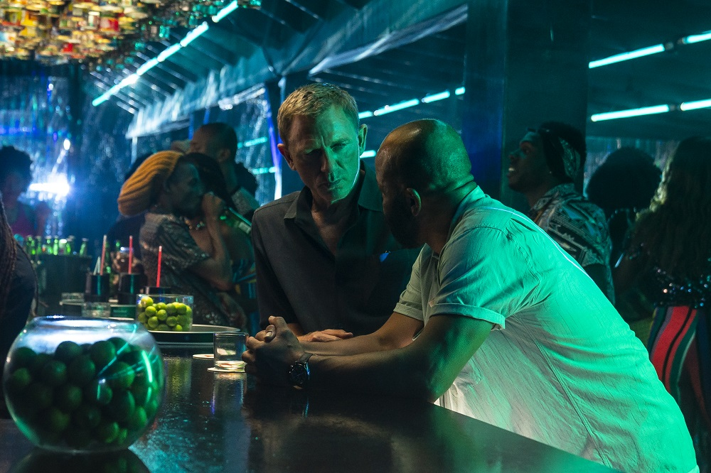 Still of Daniel Craig and Jeffrey Wright in No Time to Die.