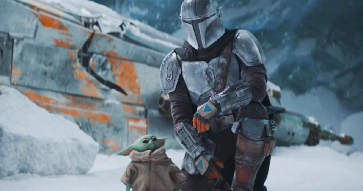 The Mandalorian and The Child looking out over a frozen planet.