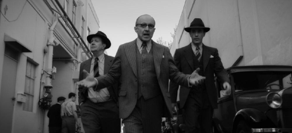 Still of Gary Oldman, Tom Burke, and Tom Pelphrey in Mank.