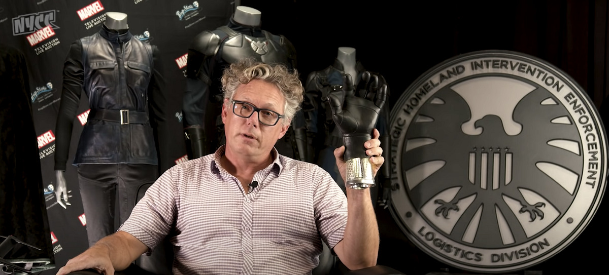 Prop Master Scott Bauer holding Phil Coulson's robo-hand from Agents of S.H.I.E.L.D. at NYCC 2020.
