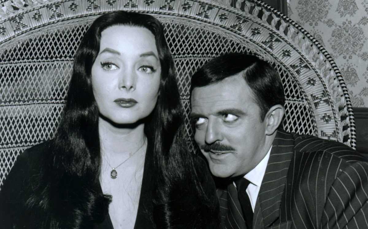 """Still of Carolyn Jones as Morticia Addams and John Astin as Gomez Addams in the classic TV series """"The Addams Family."""""""