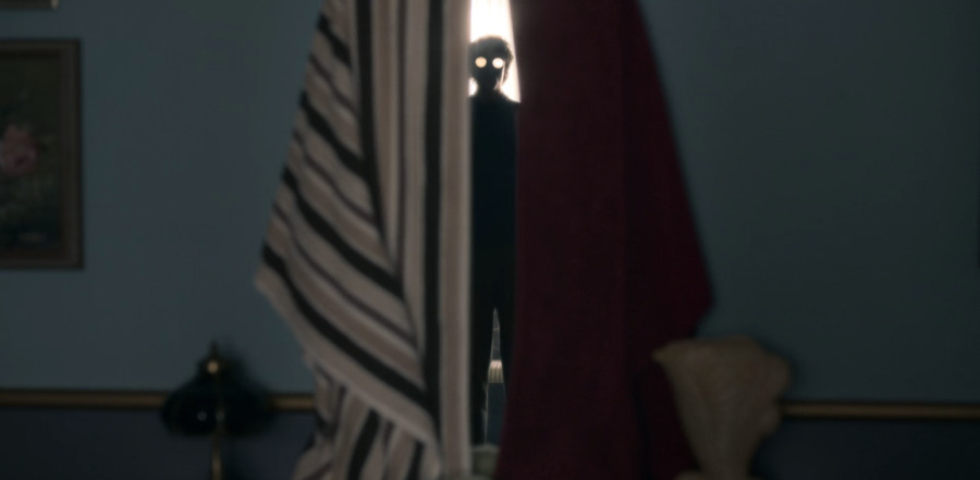Eddie OMara, portrayed by Roby Attal, haunting Dani through a mirror in The Haunting of Bly Manor.