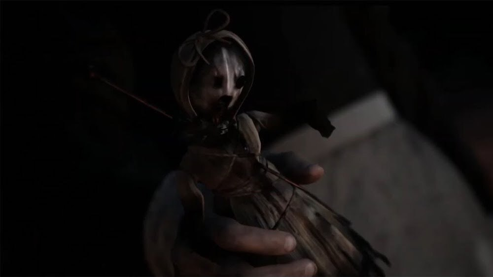 A small doll found within the town of Little Hope, one of October's Most Anticipated Games