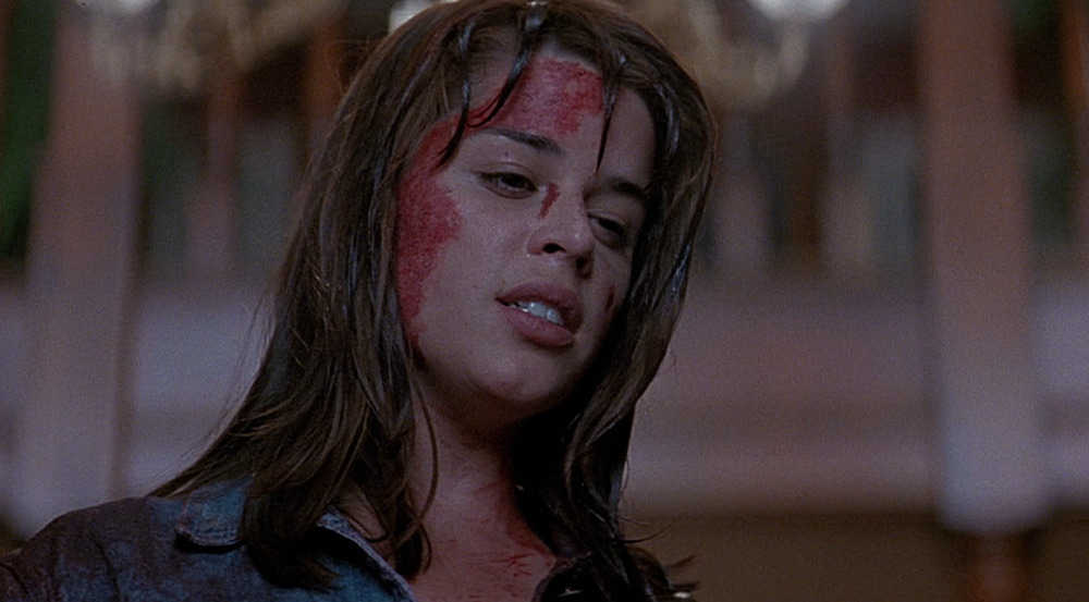 Neve Campbell as Sidney Prescott with blood on her face in Scream.