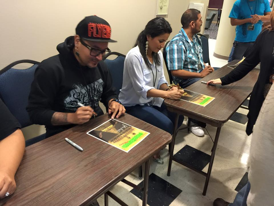 Members of the Native American Paranormal Project sign autographs at a screening