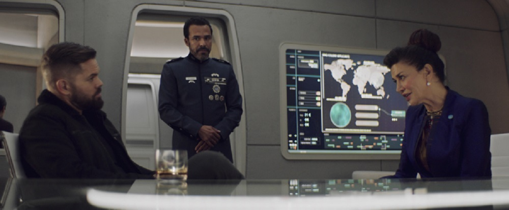 Still of Wes Chatham as Amos Burton, Michael Irby as Admiral Delgado and Shohreh Aghdashloo as Chrisjen Avasarala in The Expanse. Photo courtesy of Amazon Studios.