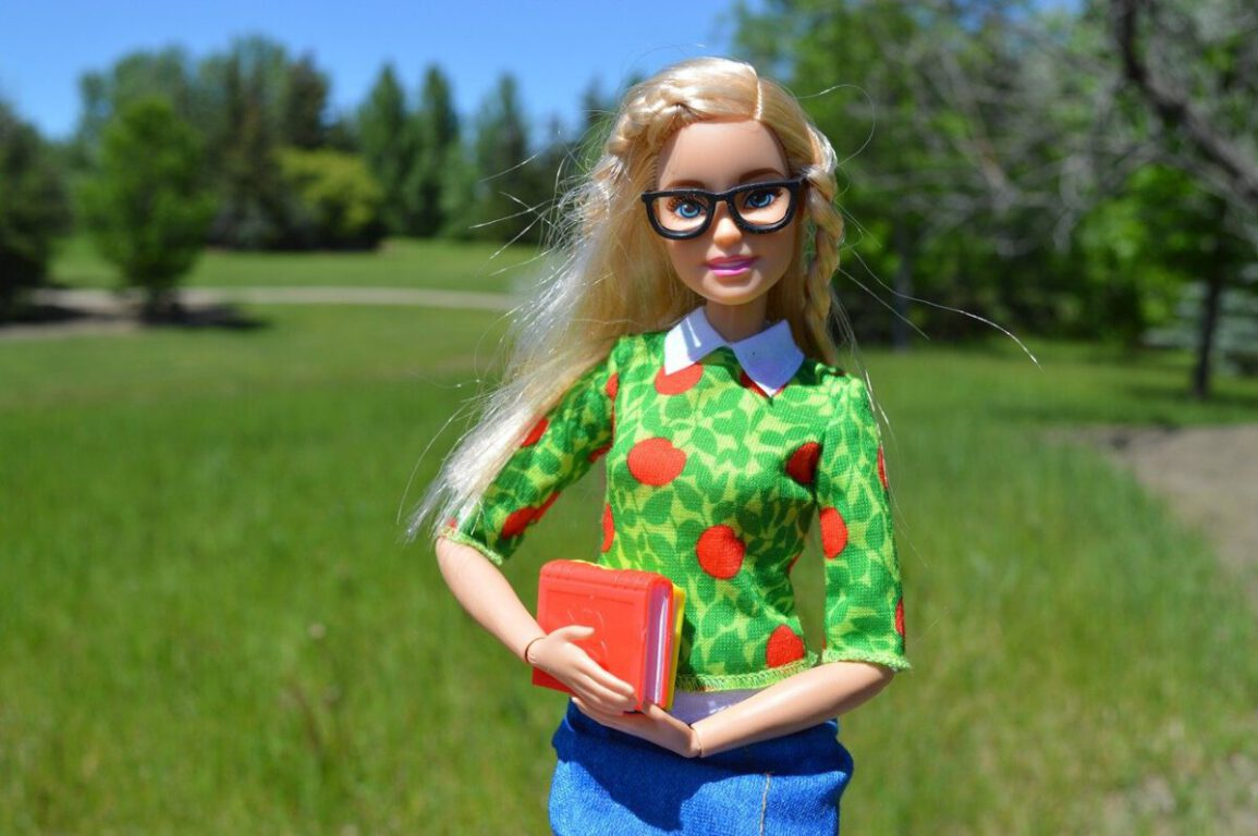Barbie with glasses and a book