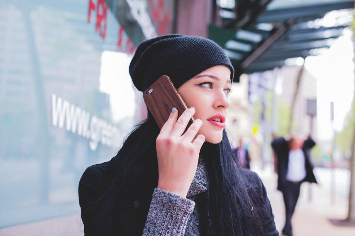 girl holding a cellphone to her ear