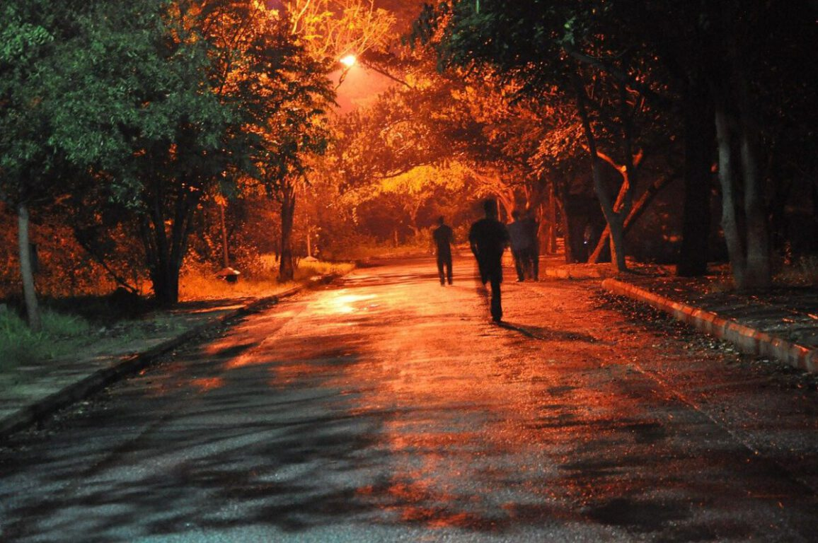 people running down an empty street