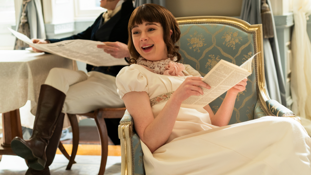 Eloise Bridgerton (Claudia Jessie) reading Lady Whistledown's scandal sheet in Bridgerton.