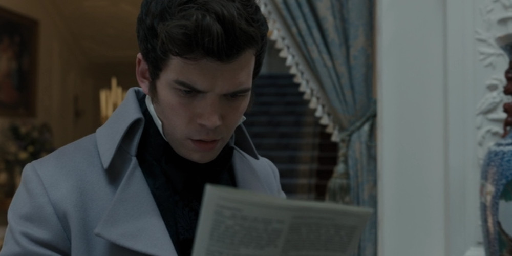 Colin reading about Marina's pregnany in Lady Whistledown's scandal sheet in Bridgerton.