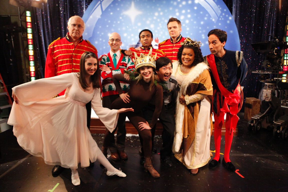 "Photo of Community cast for Christmas episode ""Regional Holiday Music."""