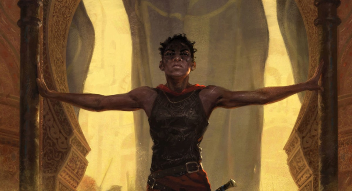 A dark skinned woman with short hair and muscular arms stands in a doorway. There is a flag behind her and dust rising