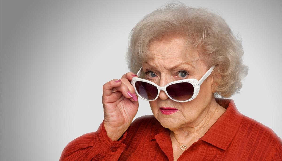 Photo of Betty White in white-framed sunglasses.