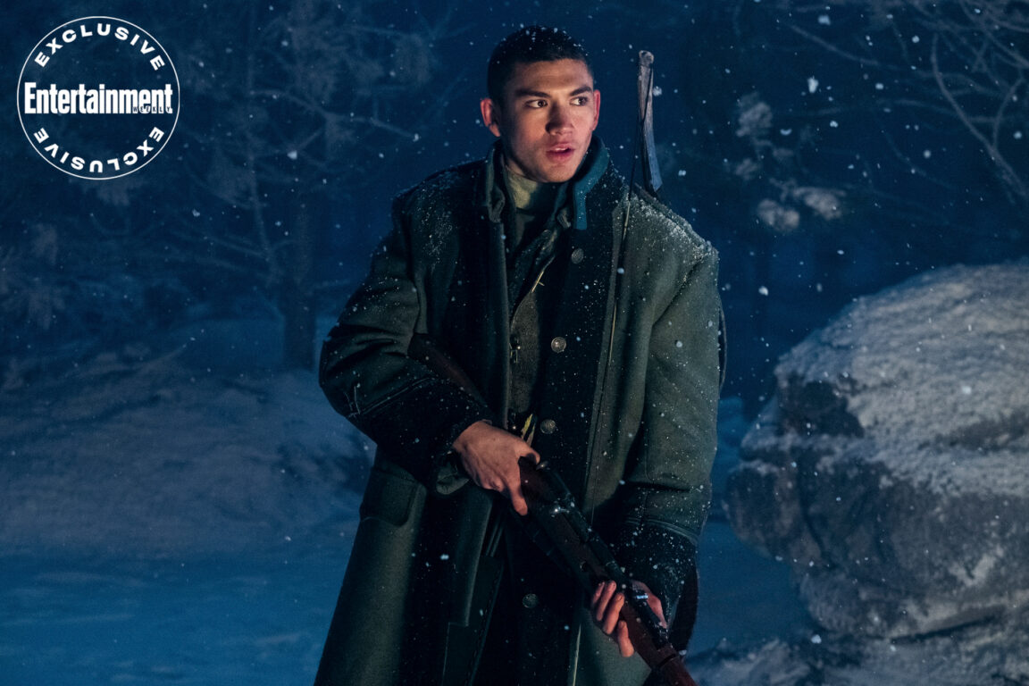 Malyen Oretsev (Archie Renaux) standing out in the snow with a gun in Shadow and Bone.