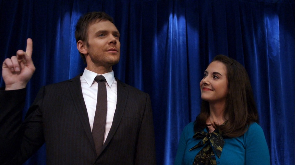 """Still of Joel McHale as Jeff Winger and Alison Brie as Annie Edison in Community episode """"Intro to Political Science."""""""