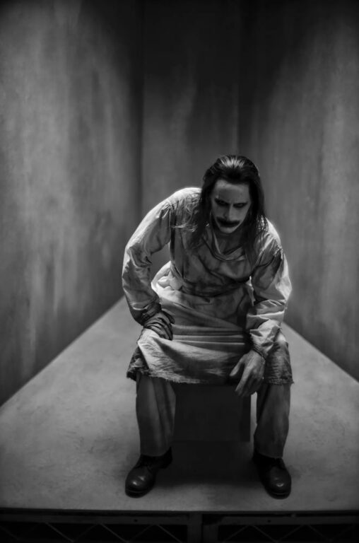 Jared Leto has the Joker sitting down wearing a medical gown and make up in Justice League.