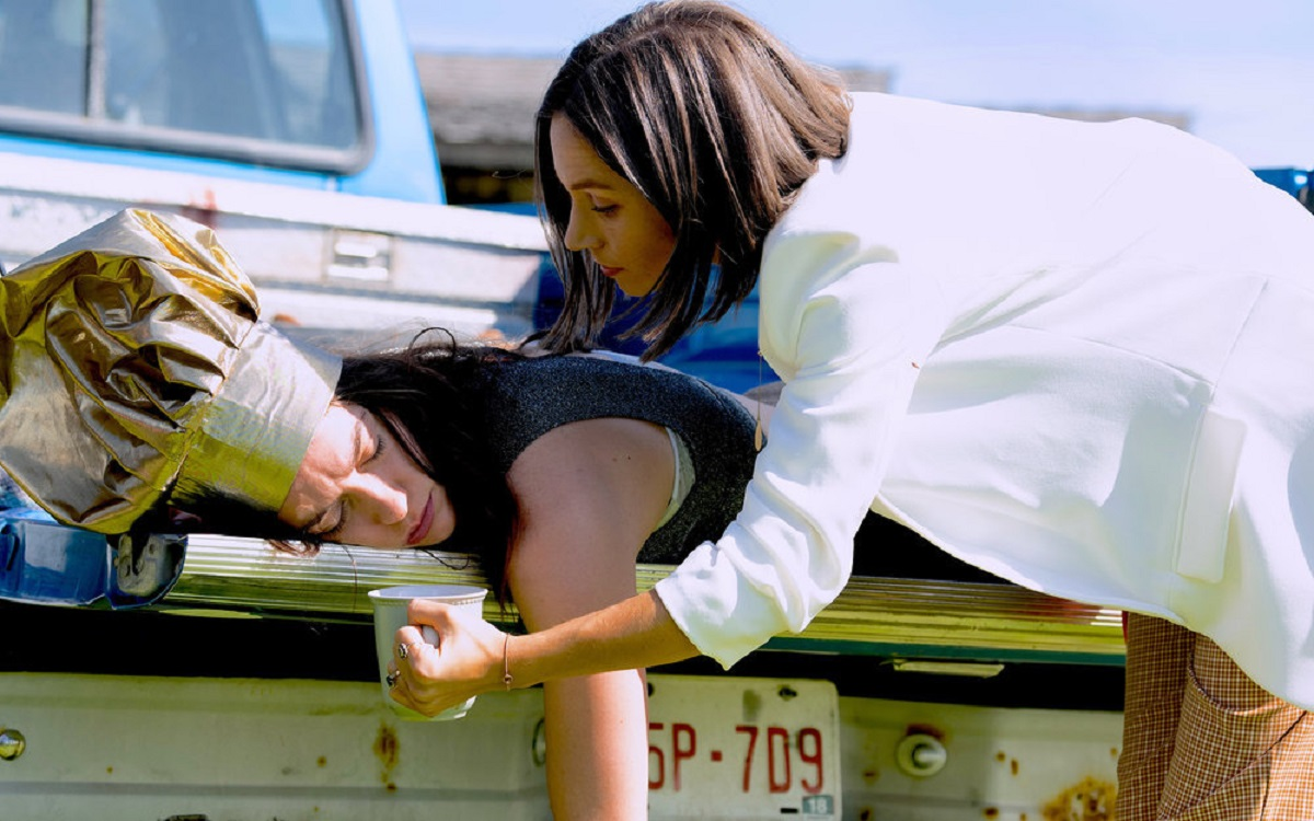 """Still of Melanie Scrofano and Dominique Provost-Chalkley in Wynonna Earp episode """"Love's All Over"""" on Syfy."""