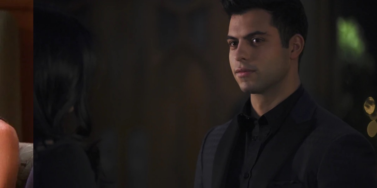Raphael stares at someone off screen.